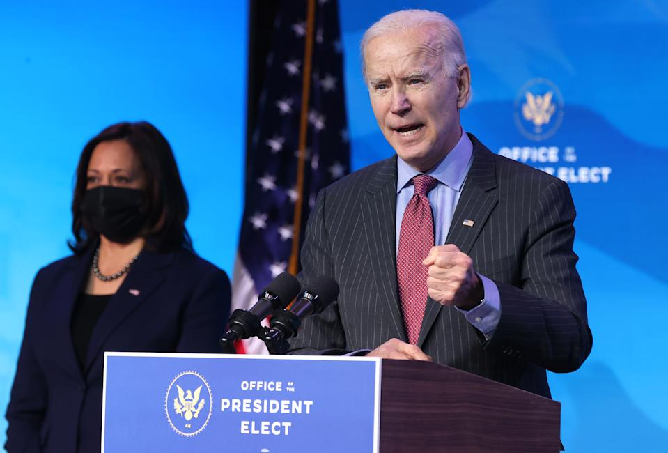 WILMINGTON, DELAWARE - JANUARY 08: U.S. Vice President-elect Kamala Harris (L) looks on as U.S. President-elect Joe Biden (R) delivers remarks after he announced cabinet nominees that will round out his economic team, including secretaries of commerce and labor, at The Queen theater on January 08, 2021 in Wilmington, Delaware. Biden announced he is nominating Rhode Island Gov. Gina Raimondo as his commerce secretary, Boston Mayor Martin J. Walsh his labor secretary and Isabel Guzman, a former Obama administration official, as head of the Small Business Administration. (Photo by Chip Somodevilla/Getty Images)