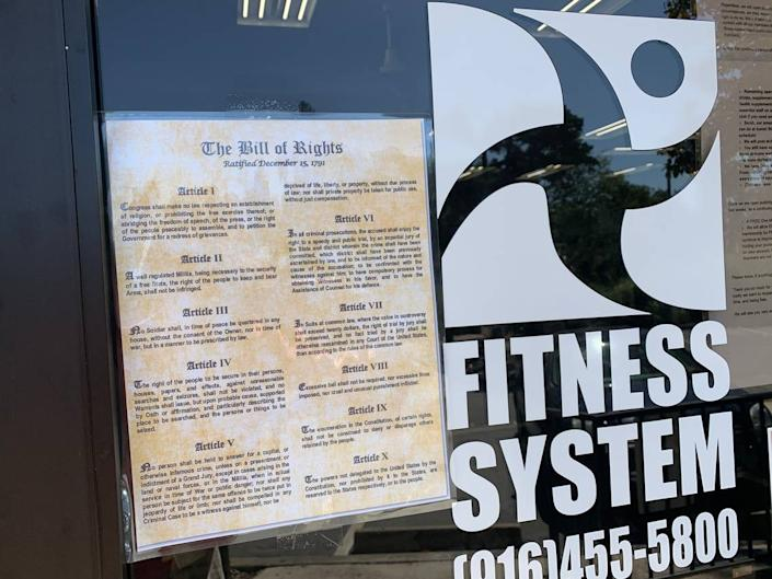 The front entrance at Fitness System's health club in Sacramento, with a copy of the Bill of Rights taped to the door. Club's owner says he will reopen Friday despite California's stay-at-home order.