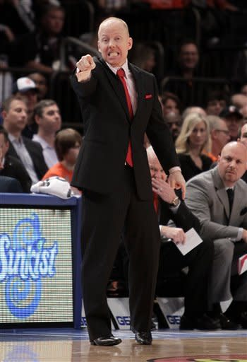 Cincinnati head coach Mick Cronin directs his team against Georgetown during an NCAA college basketball game in the quarterfinals of the Big East Conference tournament in New York, Thursday, March 8, 2012. Cincinnati beat Georgetown in double overtime 72-70. (AP Photo/Seth Wenig)