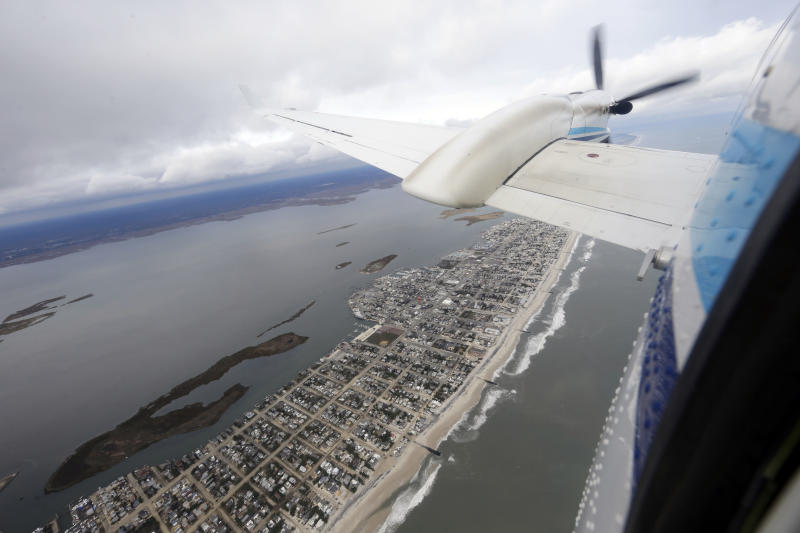 The King Air plane flies over coastal New Jersey during a National Oceanic and Atmospheric Administration flight to document coastal changes after Superstorm Sandy, Thursday, Nov. 1, 2012. (AP Photo/Alex Brandon)
