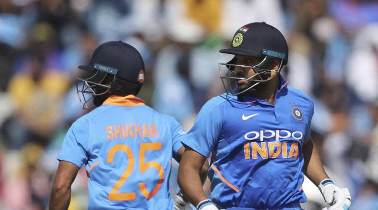 India's Rohit Sharma, right, and Shikhar Dhawan run between the wickets to score during the fourth one day international cricket match between India and Australia in Mohali