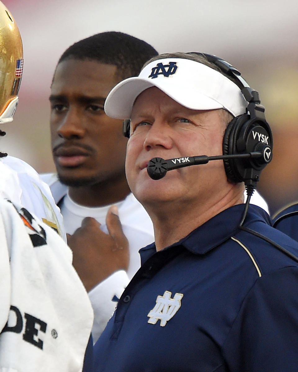 Notre Dame head coach Brian Kelly, right, looks on along with quarterback Everett Golson during the second half of an NCAA college football game against Southern California, Saturday, Nov. 29, 2014, in Los Angeles. Southern California won 49-14. (AP Photo/Mark J. Terrill)