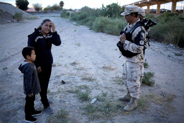 PHOTO: Guatemalan migrant Lety Perez reacts while holding hands with her son Anthony while asking members of the Mexican National Guard to let them cross into the United States, as seen from Ciudad Juarez, Mexico, July 22, 2019. (Jose Luis Gonzalez/Reuters)