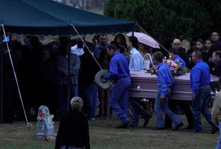 The caskets of Richard and Therese Rodriguez arrive at the graveside after the husband and wife were killed in the shooting at the First Baptist Church of Sutherland Springs in Texas, U.S., November 11, 2017.  REUTERS/Rick Wilking