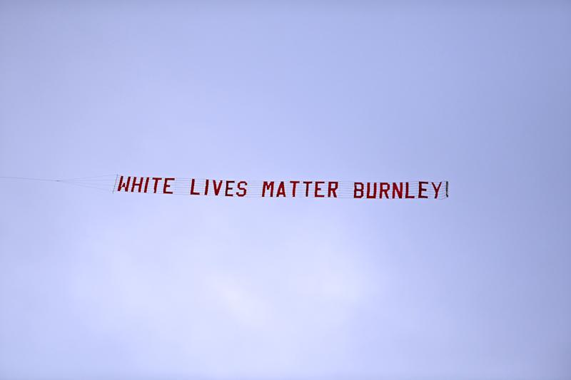 MANCHESTER, ENGLAND - JUNE 22: A plane flies over the stadium with a banner reading 'White Lives Matter Burnley' during the Premier League match between Manchester City and Burnley FC at Etihad Stadium on June 22, 2020 in Manchester, England. Football stadiums around Europe remain empty due to the Coronavirus Pandemic as Government social distancing laws prohibit fans inside venus resulting in all fixtures being played behind closed doors. (Photo by Shaun Botterill/Getty Images)
