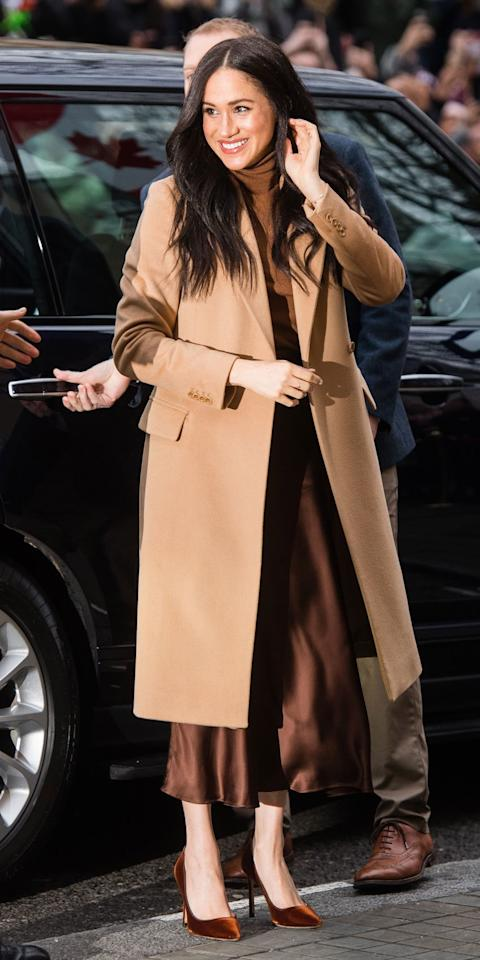 "<p>Meghan Markle made her first public appearance of the year in a <a href=""https://click.linksynergy.com/deeplink?id=93xLBvPhAeE&mid=36468&murl=https%3A%2F%2Fwww.reiss.com%2Fus%2Fp%2Fwool-blend-overcoat-womens-sabel-in-camel-brown%2F&u1=IS%2CMeghanMarkle%2Canesta%2C%2CIMA%2C3512991%2C202001%2CI"" target=""_blank"">Reiss</a> camel coat, silky Massimo Dutti skirt, coordinating Massimo Dutti turtleneck, and suede <a href=""https://click.linksynergy.com/deeplink?id=93xLBvPhAeE&mid=37499&murl=https%3A%2F%2Fus.jimmychoo.com%2Fen%2Fwomen%2Fshoes%2Fpumps%2F&u1=IS%2CMeghanMarkle%2Canesta%2C%2CIMA%2C3512991%2C202001%2CI"" target=""_blank"">Jimmy Choo</a> pumps. </p>"