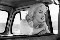 """<p>The iconic blonde bombshell, Marilyn Monroe, rose to fame in the 1950s, becoming one of America's favorite actresses and most beloved blondes, during which she was photographed often, blessing the world with some stunning Marilyn Monroe vintage photos through the years. </p><p>Born Norma Jeane Mortenson (baptized Norma Jeane Baker) in California, <a href=""""https://www.history.com/this-day-in-history/marilyn-monroe-born"""" rel=""""nofollow noopener"""" target=""""_blank"""" data-ylk=""""slk:she was in and out of foster homes growing up"""" class=""""link rapid-noclick-resp"""">she was in and out of foster homes growing up</a> because her mom and both maternal grandparents were committed to mental institutions, according to The History Channel. At 16, Norma Jeane married one of her neighbors, James Dougherty, who later joined the Merchant Marines and was sent to the South Pacific during the Second World War. While she was working in a munitions factory, a photographer """"discovered"""" Norma Jeane and soon after, her career as a model took off. A few years later, she signed a film contract with 20th Century Fox. </p><p>Decades after her death in 1962, Marilyn Monroe continues to be a pop culture icon for her more widely known photos, like Marilyn in the white dress blowing up over the grate or posing in the pink <em>Gentlemen Prefer Blondes</em> gown), but there are thousands of gorgeous vintage photos of Marilyn Monroe that you <em>haven't</em> seen on dorm room posters a zillion times before.</p>"""