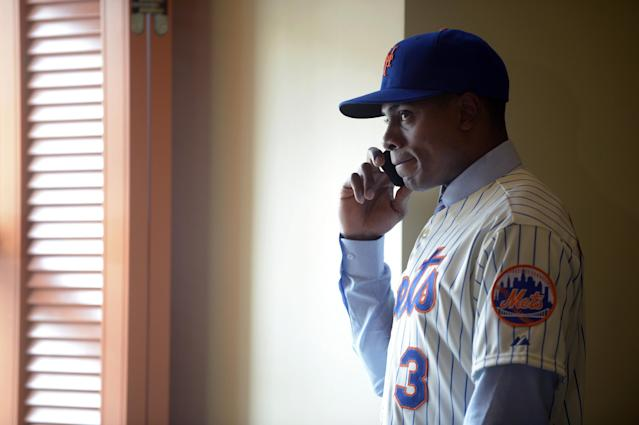 New York Mets newest outfielder Curtis Granderson talks on the phone after a news conference introducing him at baseball's winter meetings in Lake Buena Vista, Fla., Tuesday, Dec. 10, 2013.(AP Photo/Phelan M. Ebenhack)