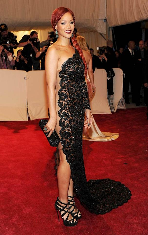 Rihanna turned heads at the 2011 MET Costume Gala thanks to her long red braid and daring lace gown by Stella McCartney. (May 2, 2011)
