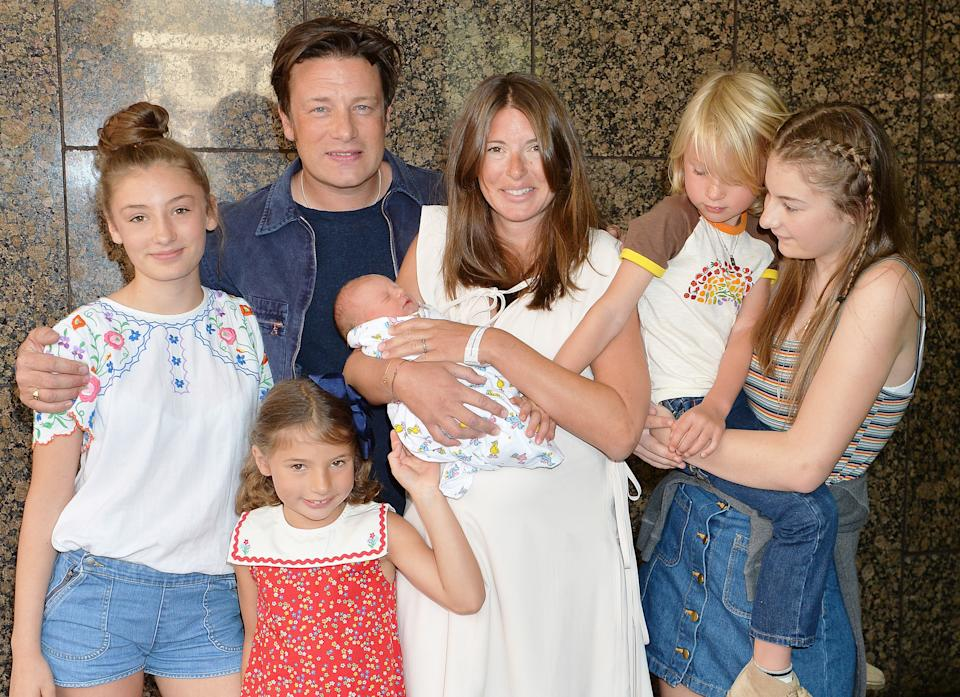 Jools and Jamie Oliver leave the Portland Hospital in central London with the newest addition to the Oliver family, a baby boy who has yet to be named, and their older children (left to right) Daisy Boo Pamela, Petal Blossom Rainbow, Buddy Bear Maurice and Poppy Honey Rosie.