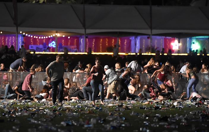 <p>People run from the Route 91 Harvest country music festival after apparent gun fire was heard on Oct. , 2017 in Las Vegas, Nevada. (Photo: David Becker/Getty Images) </p>