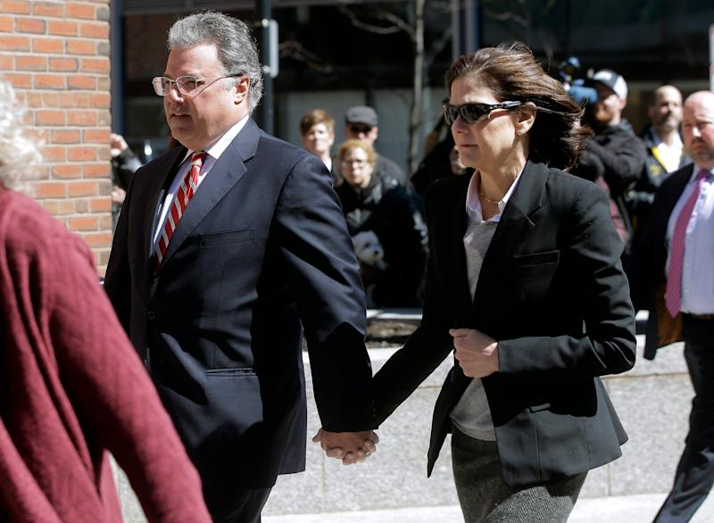 Manuel and Elizabeth Henriquez arrive at federal court in Boston on Wednesday, April 3, 2019, to face charges in a nationwide college admissions bribery scandal.
