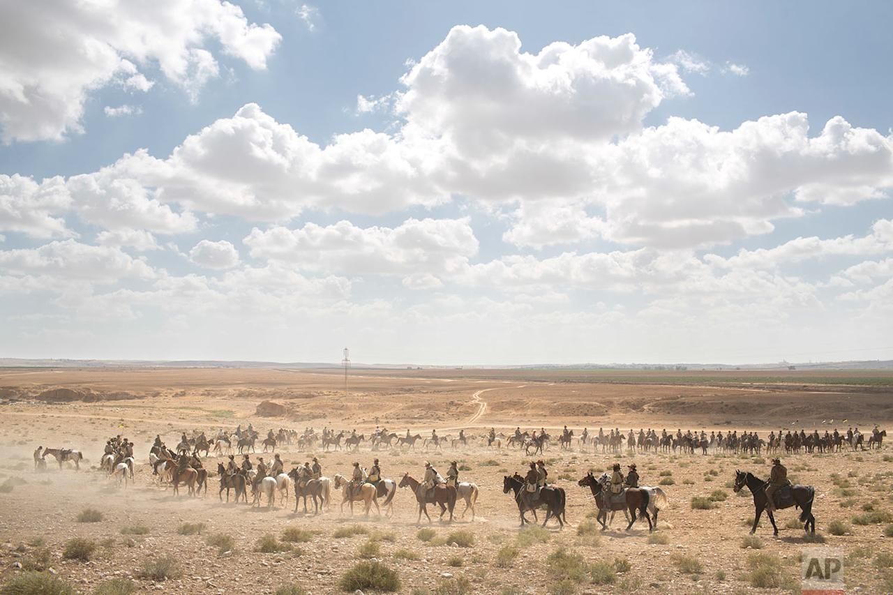 <p>History enthusiasts and descendants of Australian Mounted Division and ANZAC (Australian and New Zealand Mounted Division) Mounted Division soldiers ride their horses during the reenactment of the Battle of Beersheba, when British and ANZAC forces captured Beersheba from the Ottoman Empire during the World War I, as part of the 100 years anniversary in near Beersheba, southern Israel. (AP Photo/Oded Balilty) </p>