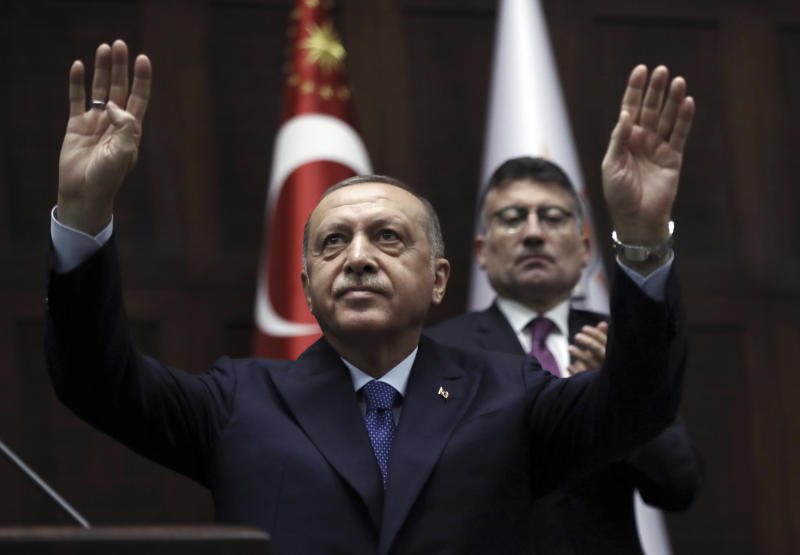 Turkish President Recep Tayyip Erdogan gestures as he addresses his ruling party legislators at the Parliament, in Ankara, Wednesday, Oct 16, 2019. Erdogan called Wednesday on Syrian Kurdish fighters to leave a designated border area in northeast Syria 'as of tonight' for Turkey to stop its military offensive, defying pressure on him to call a ceasefire and halt its incursion into Syria.(AP Photo/Burhan Ozbilici)