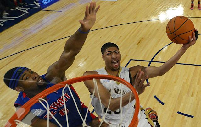 Team Webber's Anthony Davis of the New Orleans Pelicans heads to the basket as Team Hill's Andre Drummond of the Detroit Pistons defends look son during the Rising Star NBA All Star Challenge Basketball game,, Friday, Feb. 14, 2014, in New Orleans. (AP Photo/Bob Donnan, Pool)