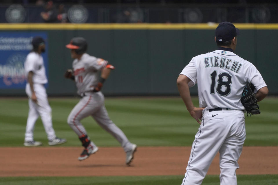 Seattle Mariners starting pitcher Yusei Kikuchi (18) watches as Baltimore Orioles' Pat Valaika rounds the bases after he hit a solo home run in the seventh inning of a baseball game, Wednesday, May 5, 2021, in Seattle. (AP Photo/Ted S. Warren)