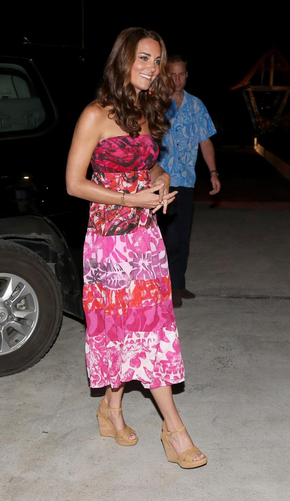 <p>Kate opted for a tropical printed dress given to her by the Solomon Islands' government along with espadrille wedges by Stuart Weitzman. </p><p><i>[Photo: PA]</i></p>