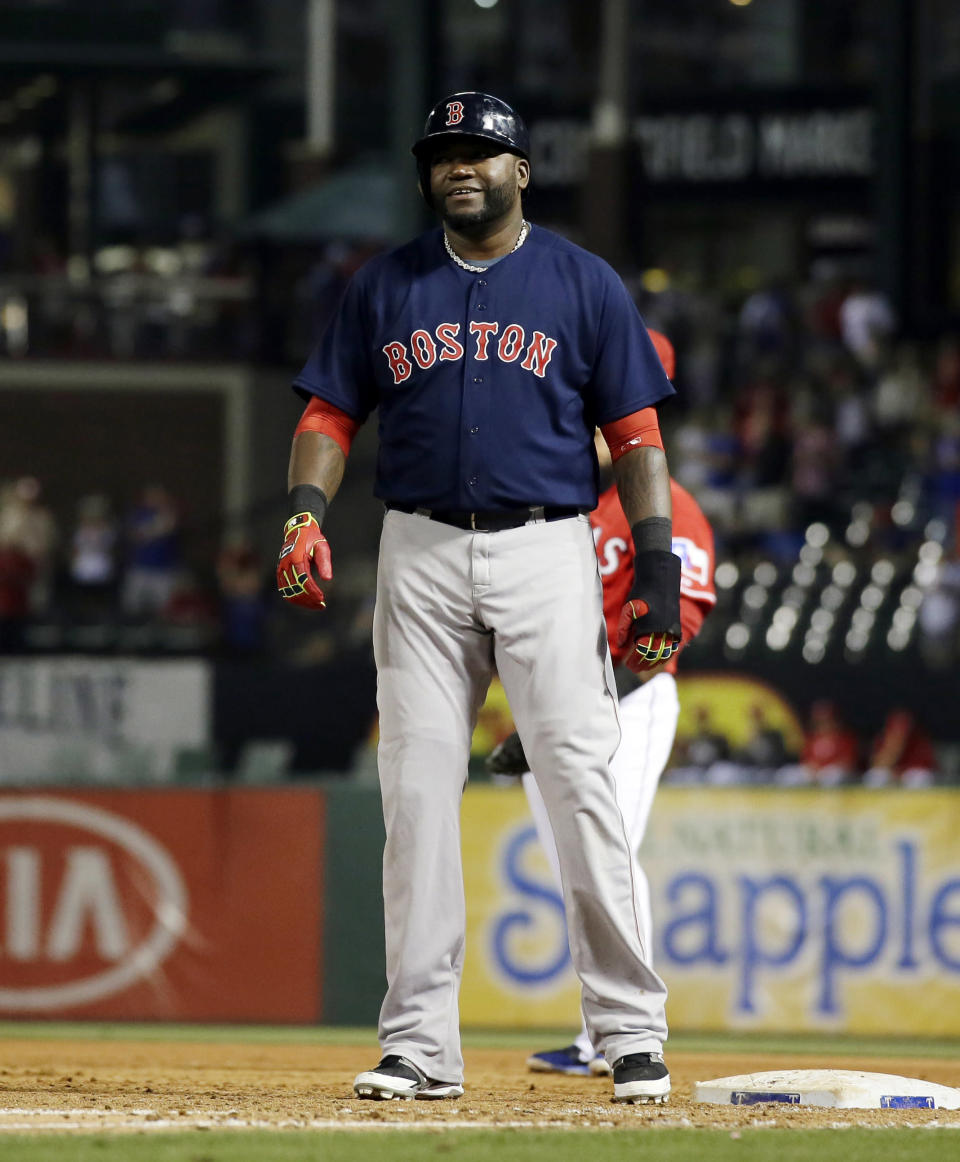 Boston Red Sox's David Ortiz stands on first after hitting a single off of Texas Rangers' Yu Darvish in the ninth inning of a baseball game, Friday, May 9, 2014, in Arlington, Texas. The hit spoiled Darvish' bid for a no-hitter in the 8-0 Rangers win. (AP Photo/Tony Gutierrez)