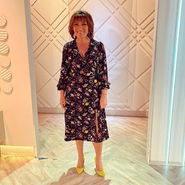 """<p>Lorraine looks out of this world in an unusual planet print dress from Joanie. The yellow shows are a nice touch too.</p><p><strong>Joanie</strong></p><p>Lucid Space Print Midi Dress - £48.00</p><p><a class=""""body-btn-link"""" href=""""https://go.redirectingat.com?id=127X1599956&url=https%3A%2F%2Fjoanieclothing.com%2Flucid-space-print-midi-dress.html&sref=https%3A%2F%2Fwww.prima.co.uk%2Fleisure%2Fcelebrity%2Fg30751501%2Florraine-kelly-fashion%2F"""" target=""""_blank"""">BUY NOW</a></p>"""