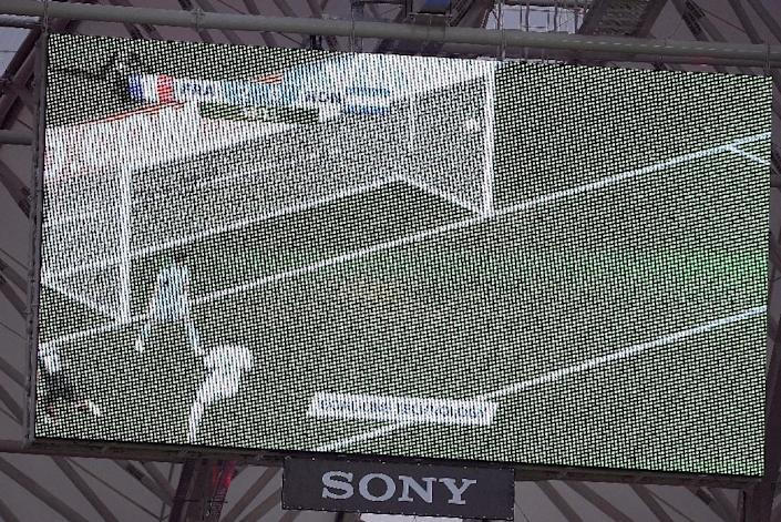A giant screen in the stadium shows a replay of France striker Karim Benzema's shot using new goal-line technology during a 2014 World Cup match against Honduras in Porto Alegre, Brazil on June 15, 2014 (AFP Photo/Franck Fife)