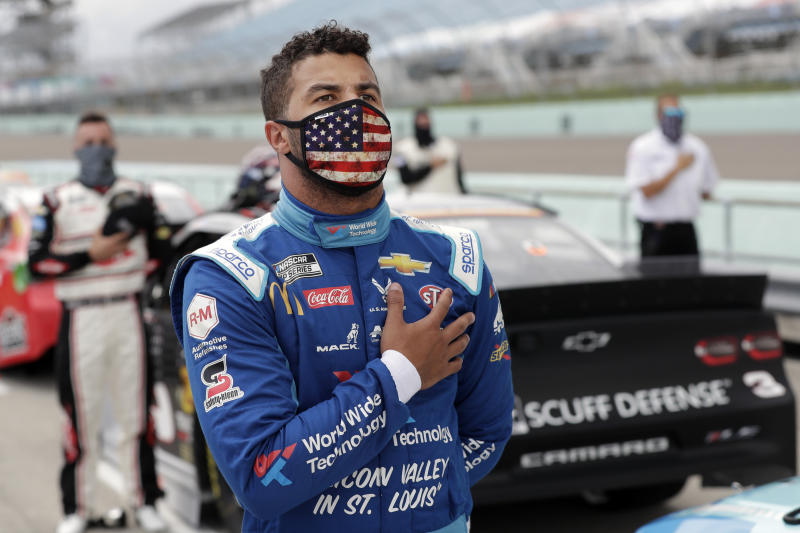 Bubba Wallace stands for the national anthem before a NASCAR race on June 14 in Homestead, Fla. (AP Photo/Wilfredo Lee)