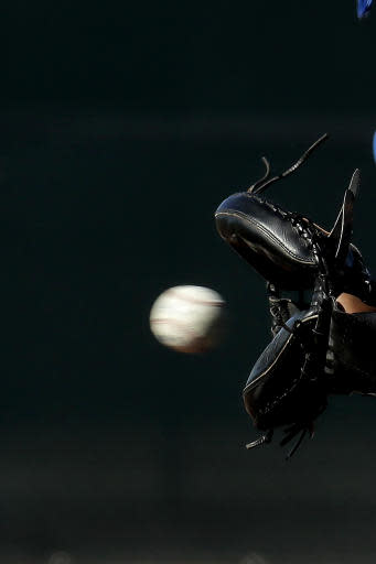 Kansas City Royals catcher Salvador Perez (13) catches a ball during spring training baseball practice Wednesday, Feb. 12, 2020, in Surprise, Ariz. (AP Photo/Charlie Riedel)