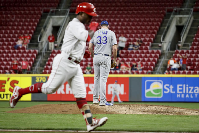Cincinnati Reds' Dilson Herrera, left, runs the bases after hitting a two-run home run off Kansas City Royals relief pitcher Brian Flynn (33) during the fifth inning of a baseball game Tuesday, Sept. 25, 2018, in Cincinnati. (AP Photo/John Minchillo)