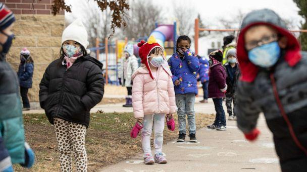 PHOTO: Students line up on designated spots after recess before returning to their classrooms at G.D. Jones Elementary in Wausau, Wis., Dec. 7, 2020. (Jenn Ackerman/The New York Times via Redux, FILE)