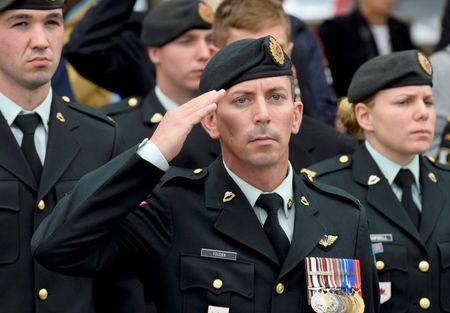 A soldier salutes as the casket passes following the funeral service for Cpl. Nathan Cirillo in Hamilton, Ontario October 28 2014. REUTERS/Aaron Harris