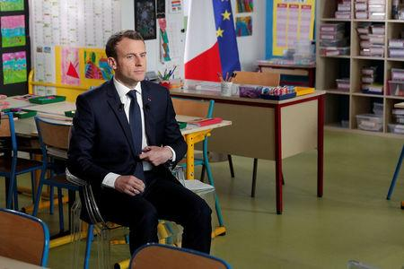 Facing strikes, France's Macron defends economic vision
