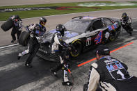 Kevin Harvick makes a pit stop during a NASCAR Cup Series auto race Sunday, March 7, 2021, in Las Vegas. (AP Photo/John Locher)