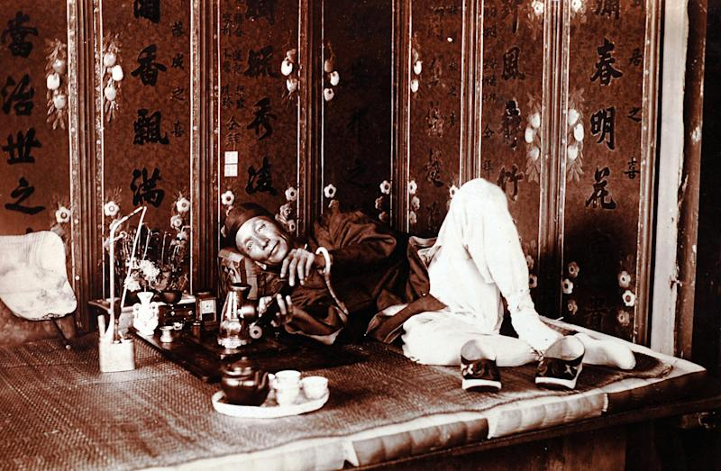 "In this photo taken in about 1920 and released by American author Steven Martin, a Chinese man smokes in a very upscale opium den in China. One Halloween night, in a blacked-out bedroom in Bangkok's Chinatown, Steven Martin went into physical and mental free fall. High fever oscillated with shivering cold, gut-wrenching stomach pains brought on waves of diarrhea. Howling in agony, he leapt around the room in a kind of devil dance, his body smeared with oily sweat, vomit, mucus and feces. ""Opium Fiend, A 21st Century Slave to a 19th Century Addiction'' opens with this harrowing description of the author trying to cut himself off from a drug that had taken over his life as a freelance journalist in Southeast Asia. Although Martin doesn't advocate the use of opium, his memoir is no simple cautionary tale, nor was he your ordinary backpacker junkie, such as still roam this region of cheap and plentiful drugs. (AP Photo/Courtesy of Steven Martin) EDITORIAL USE ONLY, NO SALES"