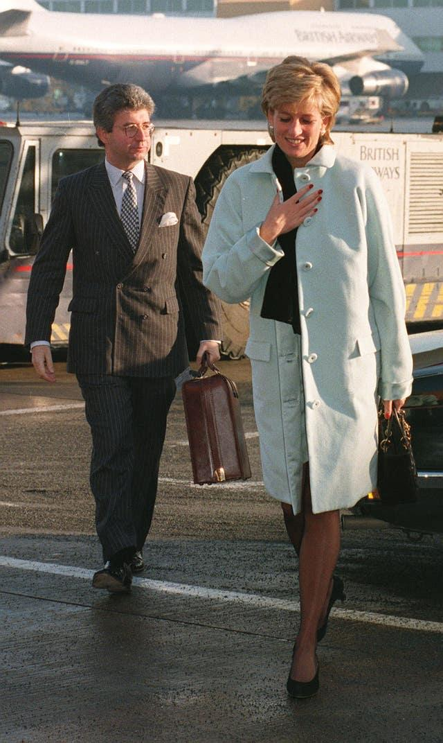 Diana with her then private secretary Patrick Jephson, at Heathrow Airport. Tim Ockenden/PA Wire
