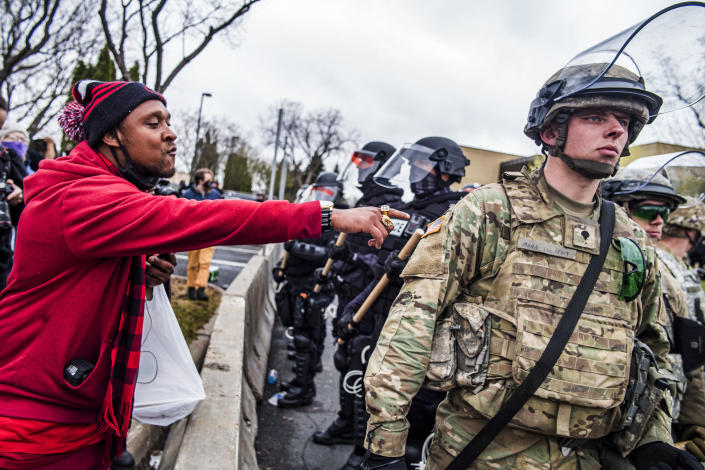 A protester points out to a National Guardsman while protesting the fatal shooting by police of Daunte Wright at a rally at the Brooklyn Center Police Department in Brooklyn Center, Minn., Monday, April 12, 2021. (Richard Tsong-Taatarii/Star Tribune via AP)