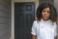 **HOLD FOR JUSTIN MYERS STORY** Crystal Marie McDaniels stands in front of her Charlotte, N.C. home on Friday, July 9, 2021 (AP Photo/Nell Redmond)
