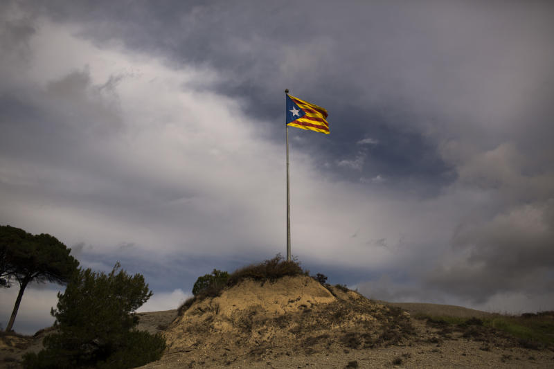 """In this photo taken on Saturday, Nov. 10, 2012, a pro-independence """"estelada"""" flag is seen on top of a mountain near Hostalets de Balenya, a village declared by the city council a """"free Catalan territory"""" in Spain. Catalonia holds elections on Sunday that will be seen as a test of the regional government's plans to hold a referendum on independence, and one of the key issues emerging is the theoretical place of a free Catalonia in Europe. (AP Photo/Emilio Morenatti)"""