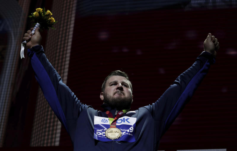 Joe Kovacs, of the United States, gold, during the medal ceremony for the men's shot put final at the World Athletics Championships in Doha, Qatar, Saturday, Oct. 5, 2019. (AP Photo/Nariman El-Mofty)