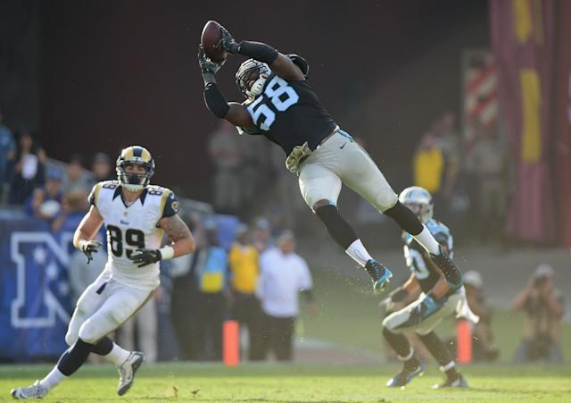 <p>Thomas Davis #58 of the Carolina Panthers catches the ball for an interception during the third quarter of the game against the Los Angeles Rams at the Los Angeles Coliseum on November 6, 2016 in Los Angeles, California. (Photo by Harry How/Getty Images) </p>