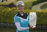 Wei-Ling Hsu, of Taiwan, holds the winners trophy as she celebrates winning the LPGA Tour's Pure Silk Championship golf tournament in Williamsburg, Va., Sunday, May 23, 2021. (AP Photo/Steve Helber)