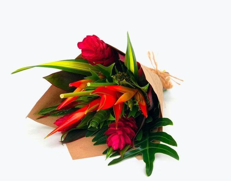 "<h2>Protea, Craspedia, or Bird of Paradise<br></h2><br><strong>Best for: Aquarius Moms</strong><br>""Surprise your Aquarian mother with something as unique as them. Look for Protea, Craspedia, or Bird of Paradise; not-so-typical flower for your not-so-typical mom.""<br><br><em>Shop</em> <strong><em><a href=""http://bloomsybox.com"" rel=""nofollow noopener"" target=""_blank"" data-ylk=""slk:Bloomsy Box"" class=""link rapid-noclick-resp"">Bloomsy Box</a></em></strong><br><br><strong>Bloomsy Box</strong> Tropical Treasure, $, available at <a href=""https://go.skimresources.com/?id=30283X879131&url=https%3A%2F%2Fwww.bloomsybox.com%2Fp%2Ftropical-treasure"" rel=""nofollow noopener"" target=""_blank"" data-ylk=""slk:Bloomsy Box"" class=""link rapid-noclick-resp"">Bloomsy Box</a>"
