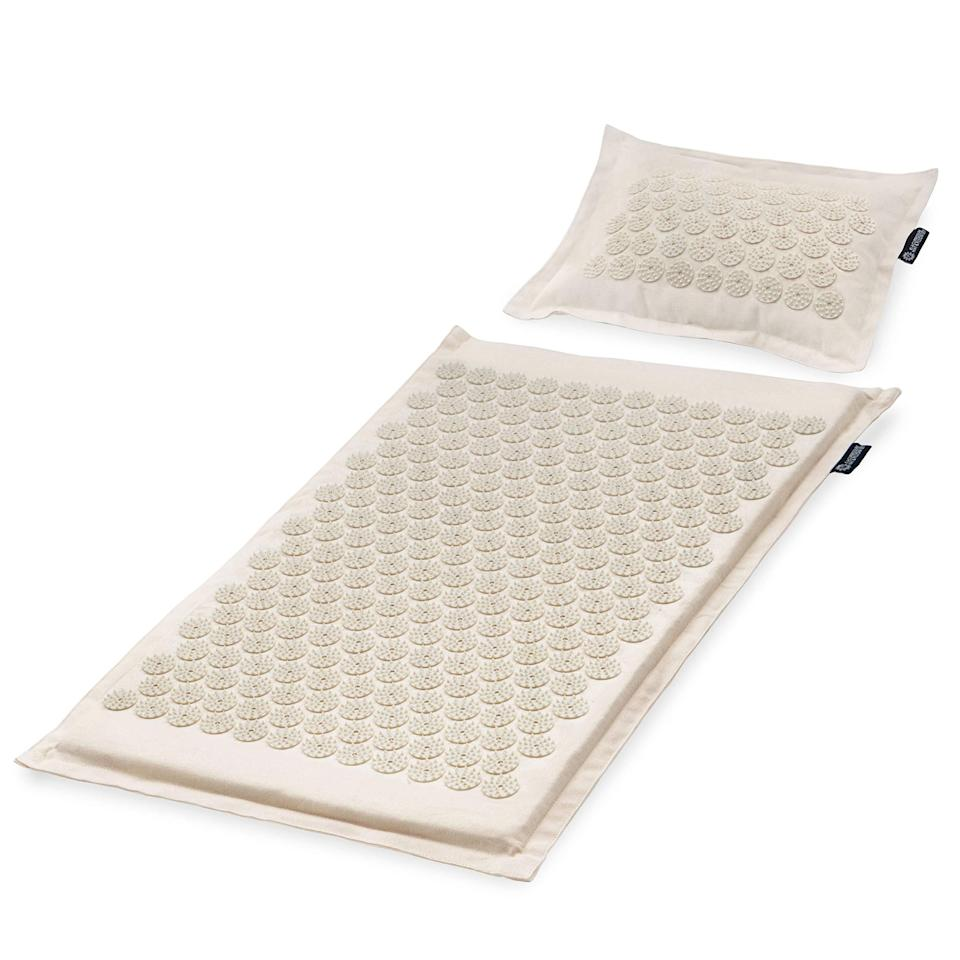 """<h3>Acupressure Mat and Pillow Set</h3><br>Feel stress and tension melt away to the tune of 6,534 acupressure points lightly poking your body. (It feels great, we promise.)<br><br><strong>Rating:</strong> 4.3 out of 5 stars, and 30,762 reviews<br><br><strong>A Satisfied Customer Review:</strong> """"Won't lie, it hurts when you first lay down. That said after a couple of minutes and letting my body """"melt"""" into the mat the pain is replaced by a pure feeling of relaxation. It has helped with my chronic leg pain and back pain due to my walking gait being off. You have to give it an honest try. If you don't practice and let all of your muscles relax it won't work. Keep trying a little each day, it will be worth it, I promise!""""<br><br><strong>ProsourceFit</strong> Acupressure Mat and Pillow Set, $, available at <a href=""""https://amzn.to/3gqHNuw"""" rel=""""nofollow noopener"""" target=""""_blank"""" data-ylk=""""slk:Amazon"""" class=""""link rapid-noclick-resp"""">Amazon</a>"""