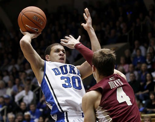 Duke's Seth Curry (30) shoots as Florida State's Deividas Dulkys (4) blocks during the first half of an NCAA college basketball game in Durham, N.C., Saturday, Jan. 21, 2012. (AP Photo/Gerry Broome)