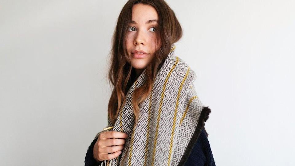 A model wearing a Bristol Cloth Project scarf