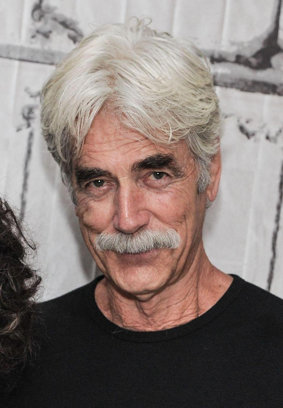 <p>Elliott's mustache is still living its best life. The only thing that's different is the fact that the actor has gone completely white. Well, except for his eyebrows. </p>