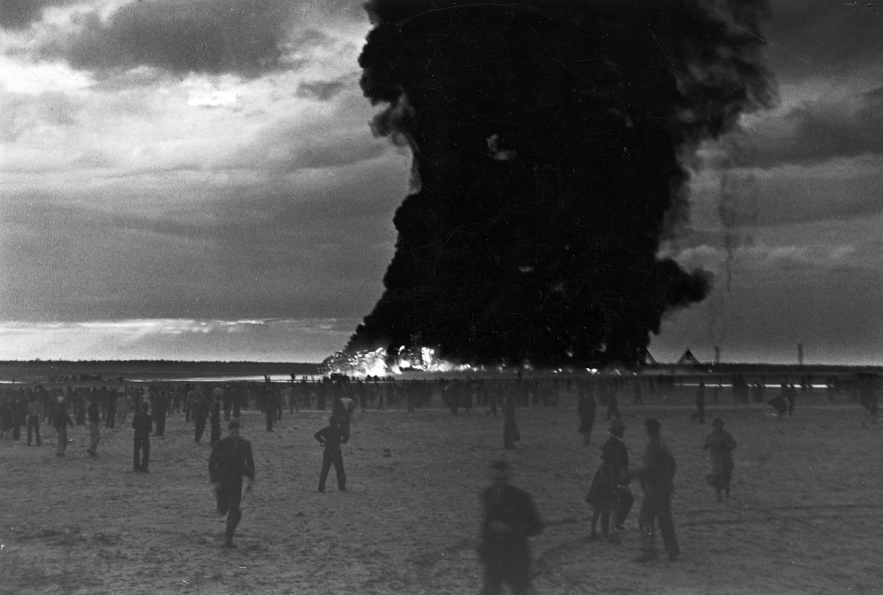 an analysis of the inferno on the arrival of the hindenburg Trenton, nj thunderstorms and wind had delayed the hindenburg's arrival in new jersey from germany on may 6, 1937 the father of 8-year-old werner doehner headed to his cabin after using his movie camera to shoot some scenes of lakehurst naval air station from the airship's dining room.