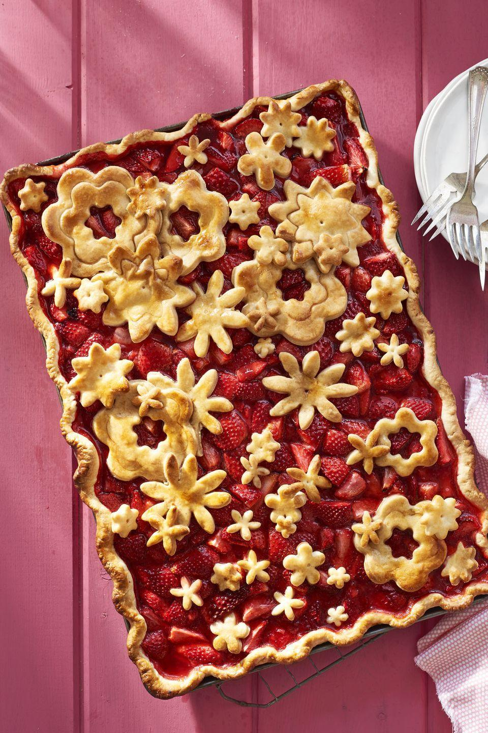 """<p>It's strawberry season, folks! Celebrate with this fruity pie.</p><p><em><a href=""""https://www.countryliving.com/food-drinks/recipes/a41978/strawberry-slab-pie-recipe/"""" rel=""""nofollow noopener"""" target=""""_blank"""" data-ylk=""""slk:Get the recipe from Country Living »"""" class=""""link rapid-noclick-resp"""">Get the recipe from Country Living »</a></em></p><p><strong>RELATED:</strong><a href=""""https://www.goodhousekeeping.com/food-recipes/g1137/fresh-strawberry-recipes/"""" rel=""""nofollow noopener"""" target=""""_blank"""" data-ylk=""""slk:20 Delicious Strawberry Recipes to Make This Spring and Summer"""" class=""""link rapid-noclick-resp""""> 20 Delicious Strawberry Recipes to Make This Spring and Summer</a></p>"""