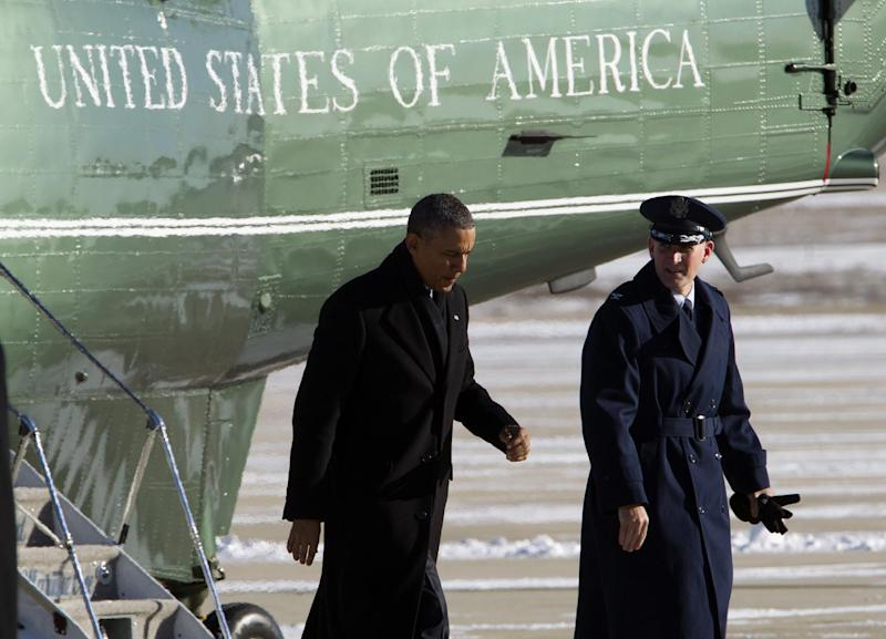 President Barack Obama, escorted by Colonel William M. Knight, Commander of the 11th Wing, walks toward Air Force One from the Marine One helicopter, upon arrival at Andrews Air Force Base, Md., Thursday, Jan. 30, 2014, en route to Waukesha, Wis., to speak about job training. This trip to Waukesha, Wis., is part of a four-stop tour President Barack Obama is making to expand on themes from his State of the Union address. ( AP Photo/Jose Luis Magana)