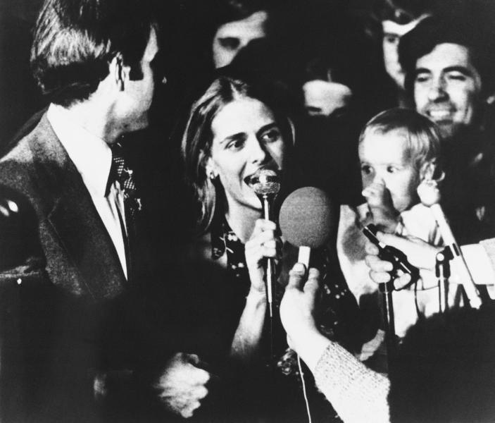 FILE - In this Nov. 7, 1972, file photo, Sen.-elect Joseph Biden, left, gives the microphone to his wife, Neilia Biden, center, in Wilmington, Del. Mrs. Biden and her daughter, Amy Biden, whom she is holding, were killed in a car crash on Dec. 18, 1972. (Jerry Habraken/The News Journal via AP)