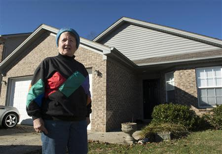 Ingrid Boak poses in front of her now-rented home in Lexington, Kentucky December 27, 2013. REUTERS/Tim Webb