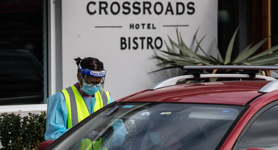 The 83-year-old was linked to the outbreak at the Crossroads Hotel. Source: AAP